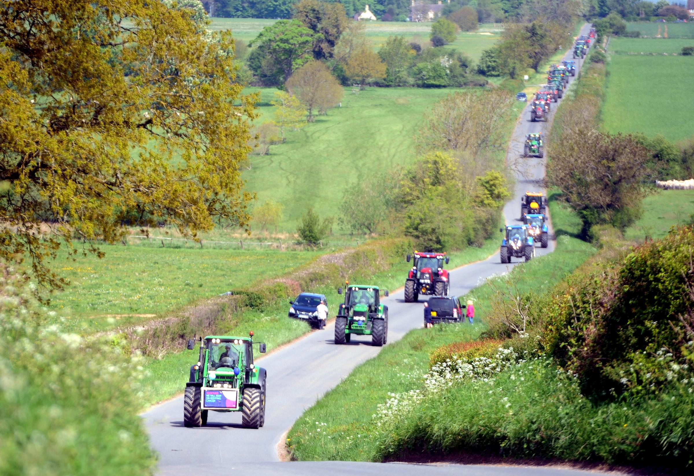 Over 70 tractors take part in the Moreton Show Tractor Committee and North Cotswold Tractor Club Bluebell Tractor Run in aid of Cancer Research UK through the Cotswolds, on Sunday 13th May 2018.  Pic: Paul Nicholls