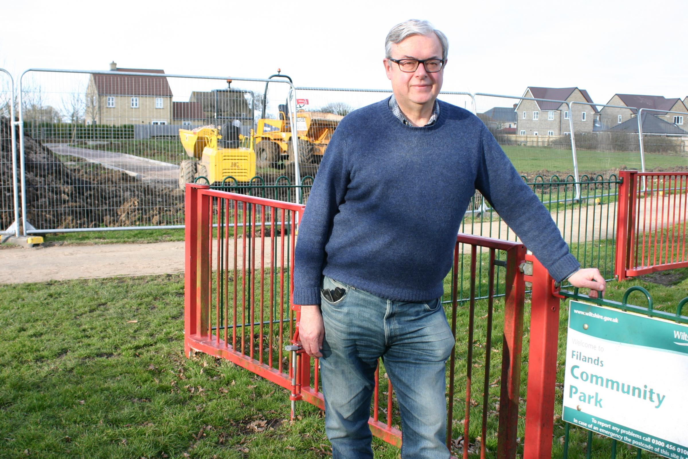 Town councillor Gavin Grant next to the Filands playpark in Malmesbury, one of two areas which are to be revamped thanks to funding given by a developer to the community.
