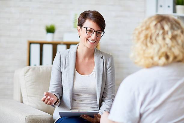 Stock image of mental health professional talking to patient