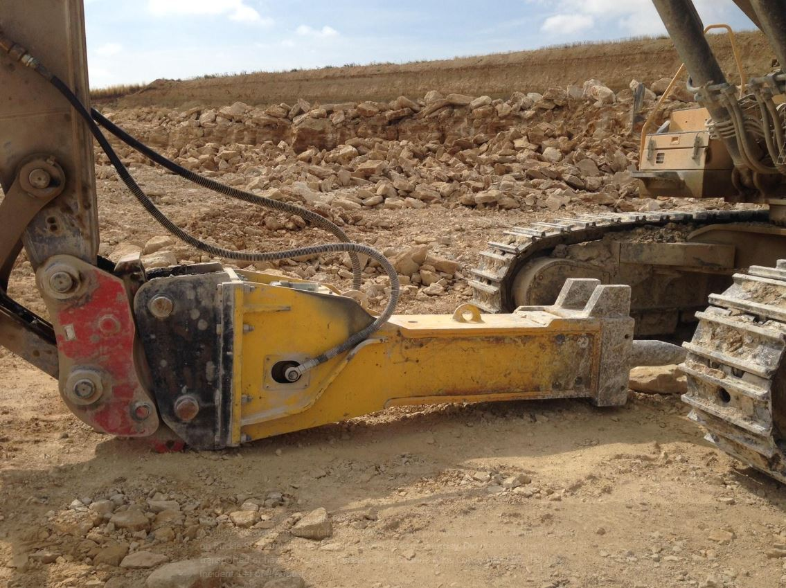 A yellow excavator breaker (similar to the one pictured) was stolen from Naunton Quarry. Picture by Cotswolds Police