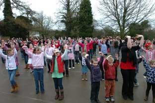 Pupils at Stratton school re-enact the T-mobile dance advert in the school playground to raise money for Comic Relief