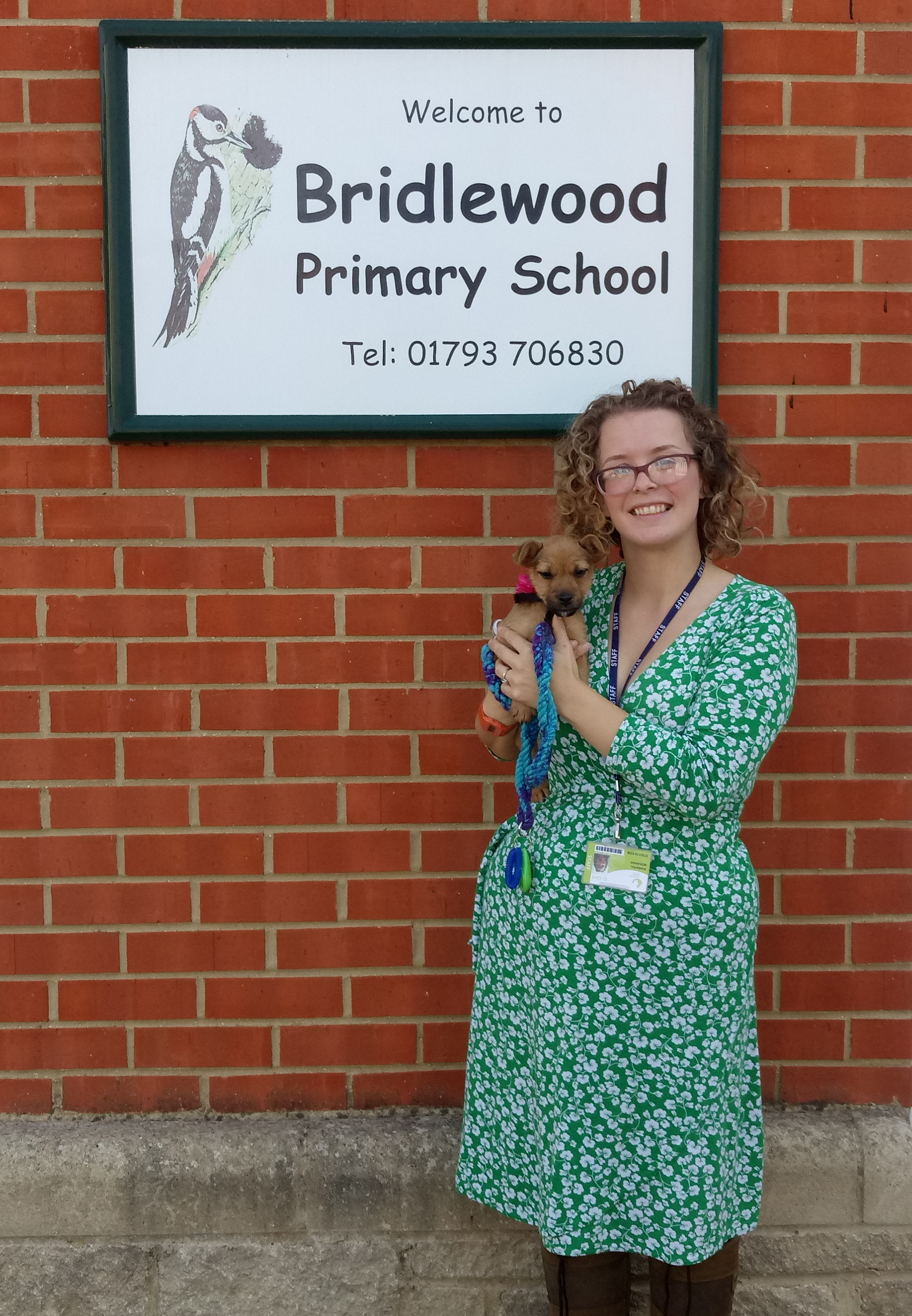 Kimberley Monahan with Daisy outside Brildewood Primary School