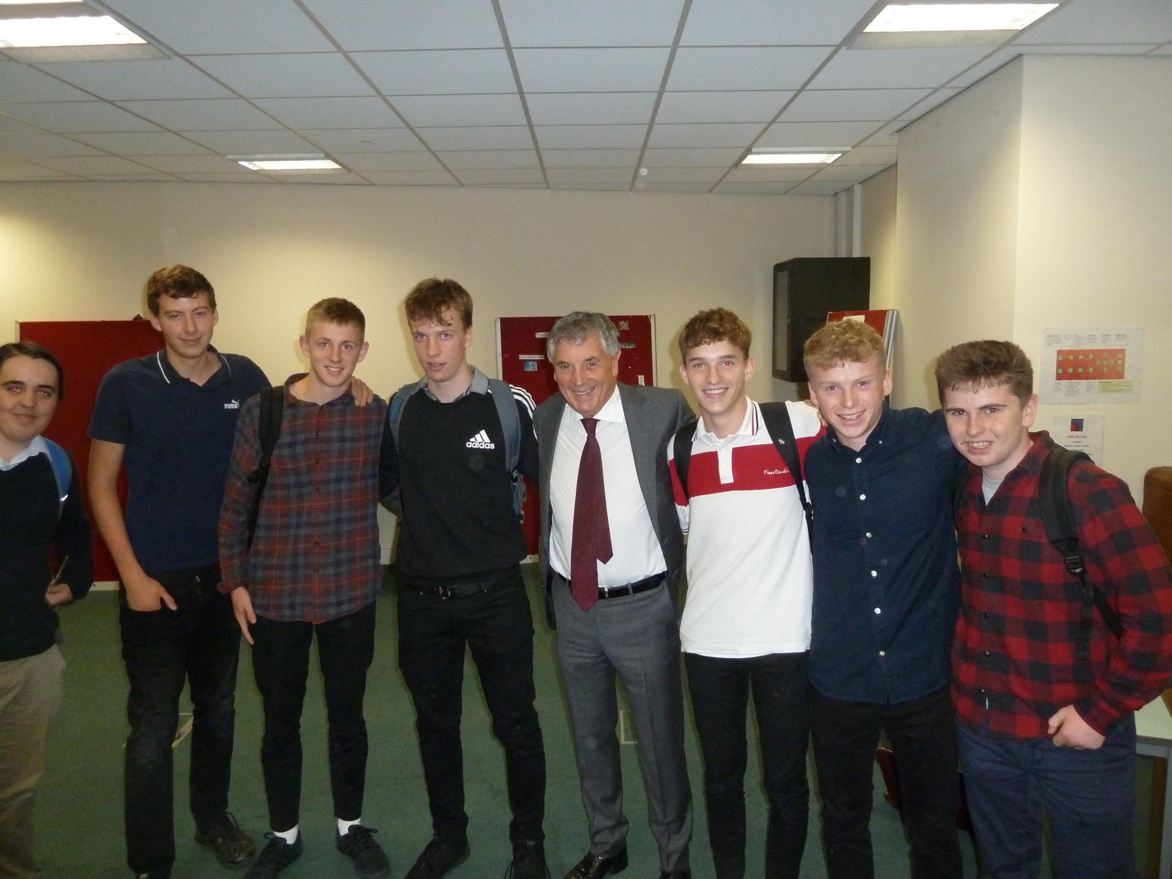David Dein (centre) pictured with students