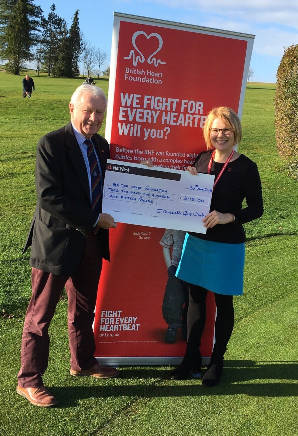 David Soar, captain of Cirencester Golf Club, presents a cheque for £3,115 to Sarah Standing of the British Heart Foundation