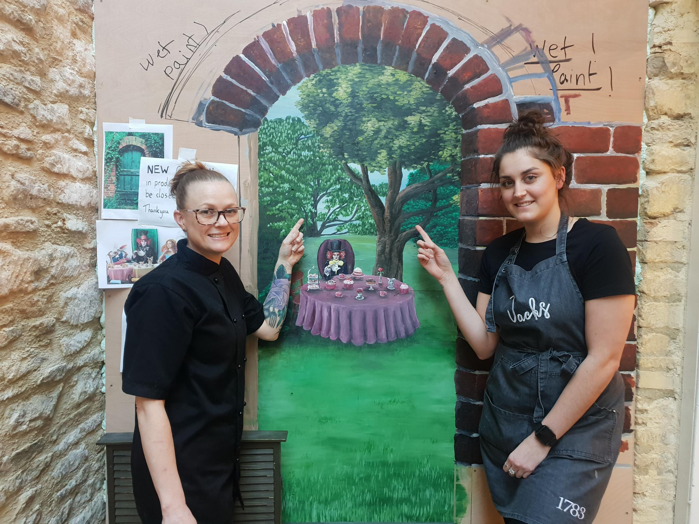 Chef Holly Raynsford and Hannah Binder point the way to the new garden