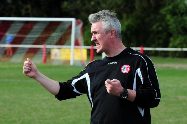 Fairford (red) v Ascot (yellow). Pic shows Fairford boss Jody Bevan.