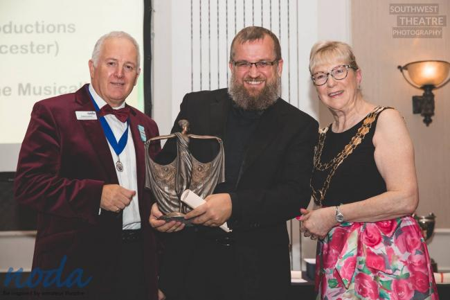 Barry Austin receiving the trophy from NODA President Jacquie Stedman and South West Regional Councillor Graham Liverton