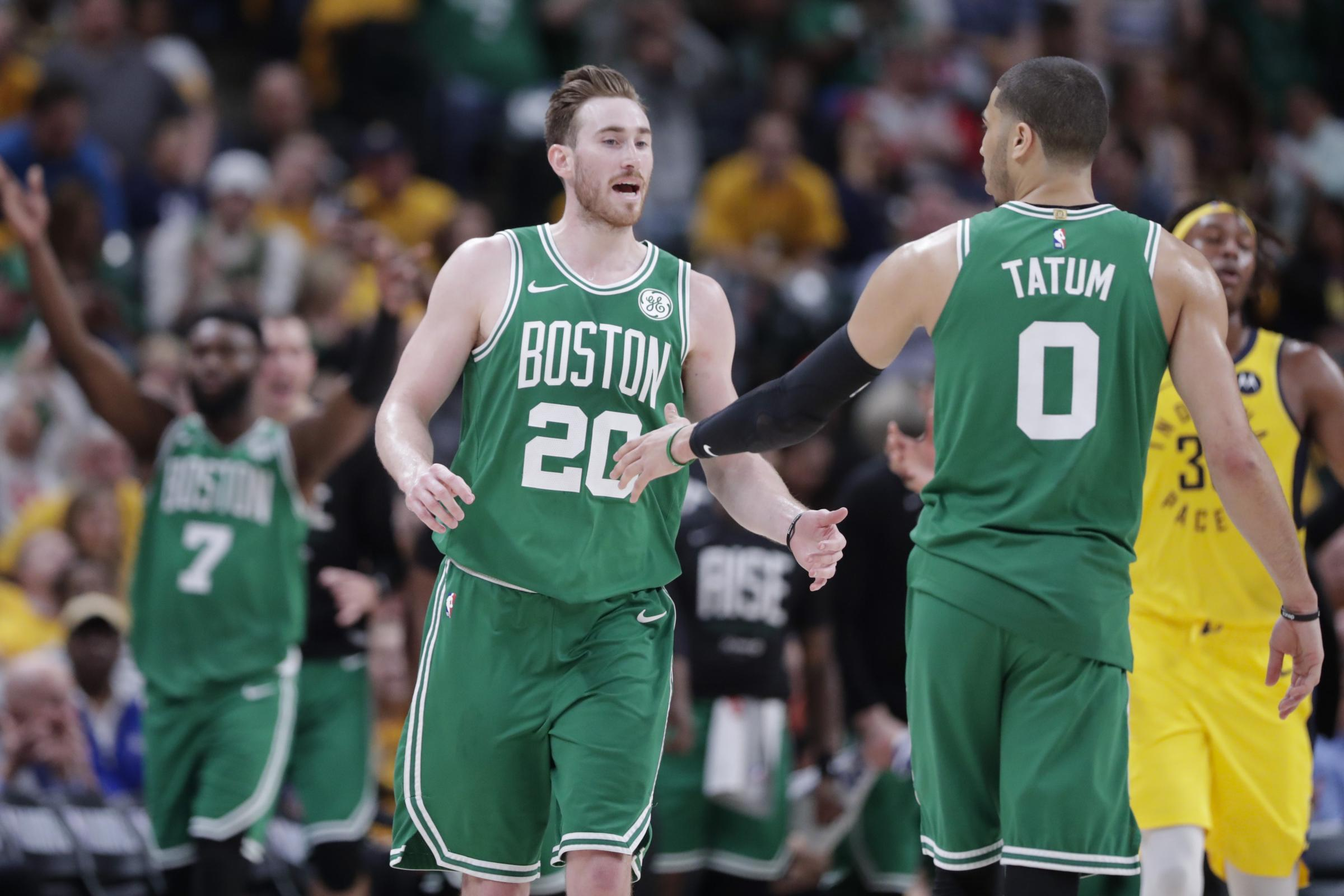 Boston Celtics' Gordon Hayward and forward Jayson Tatum celebrate during game four against the Indiana Pacers