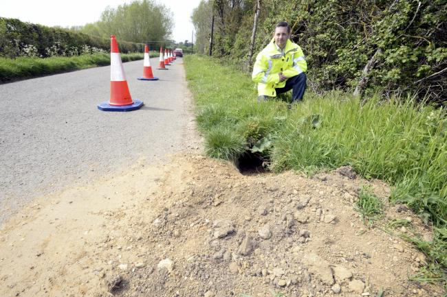 Local Highways Manager Danny Taylor on a road closed near Kempsford due to a  burrowing badger under the road. Picture by Paul Nicholls