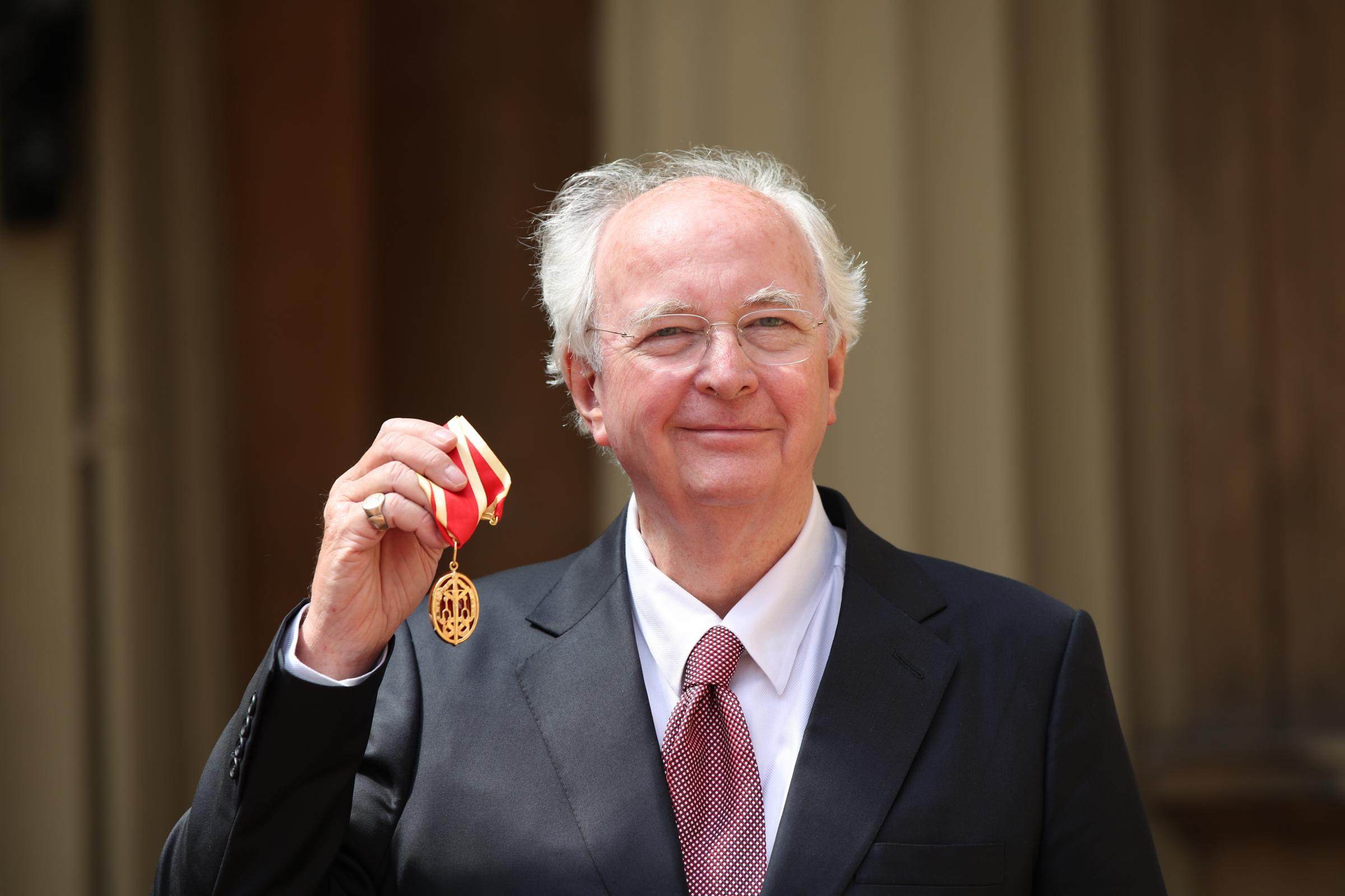Philip Pullman with his knighthood
